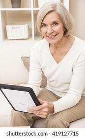 Senior woman using a tablet computer at home