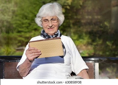 Senior woman using a  tablet PC .Reading concept