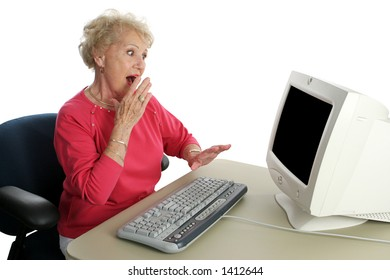 A senior woman viewing shocking internet content.  Screen intentionally blank, ready for text or image.
