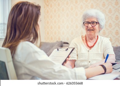 Senior woman is visited by her healthcare worker at home.