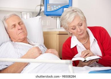Senior woman visiting husband in hospital