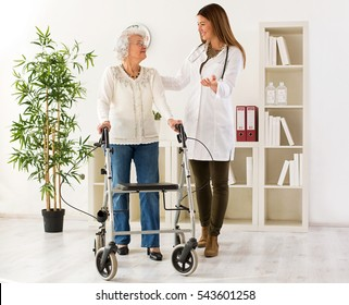 Senior woman with walker on consultation with the doctor, in ambulance