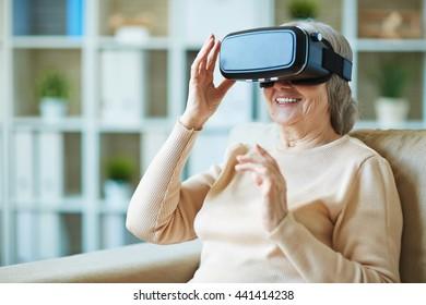 Senior woman watching video via vr glasses