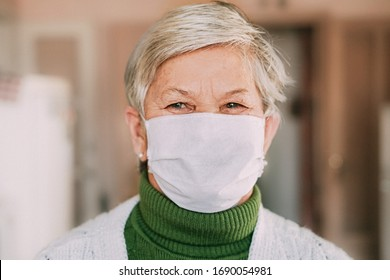 Senior woman wearing face mask during corona virus and flu outbreak. Disease and illness protection. Surgical masks for coronavirus prevention. Sick elderly patient coughing.