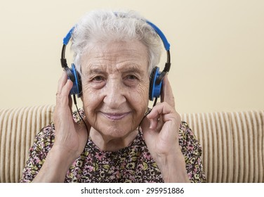 senior woman wearing headphones to listening music