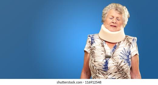 A Senior Woman Wearing A Neck brace On Blue Background