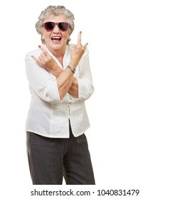 Senior woman wearing sunglasses doing funky action isolated on white background