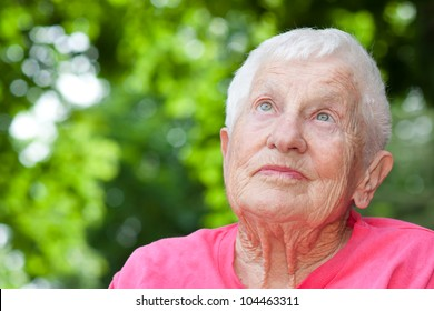 Senior Woman in a Wheelchair Looking up