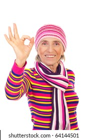 Senior woman in winter knitted clothes showing okay sign hand and smiling isolated on white background