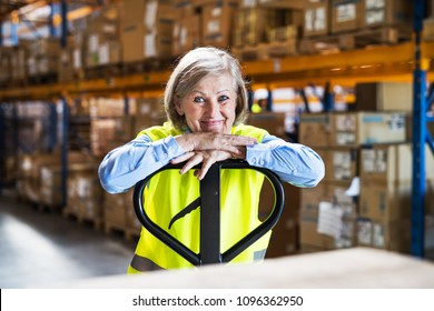 Senior woman worker or supervisor in a warehouse.