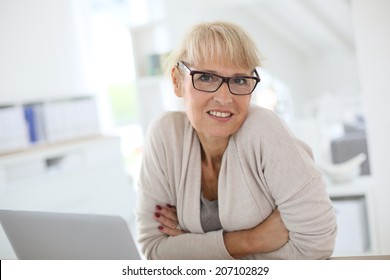 Senior woman working on laptop computer