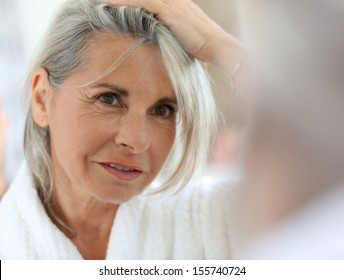 Senior woman worried by hair getting grey