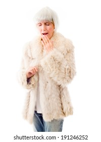 Senior woman yawning