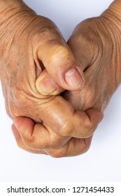 Senior woman's grasping her hands, wrinkled skin texture of blood in back of the hands on white background , Close up & Macro shot, Selective focus, Asian Body skin part, Healthcare concept