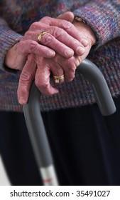 senior woman's hand on cane
