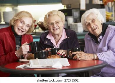 Senior women drinking tea together