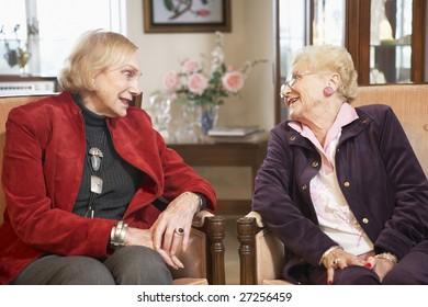 Senior women relaxing in armchairs