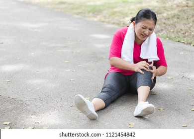 senior women suffering or injury leg after do yoga. Asian female or middle aged has pain in his foot or shin while exercise or warm up. sport woman runner hurting holding painful sprained ankle pain