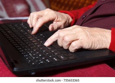 senior women writing on computer