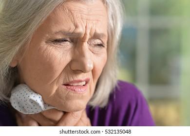 Senior wooman feels sick