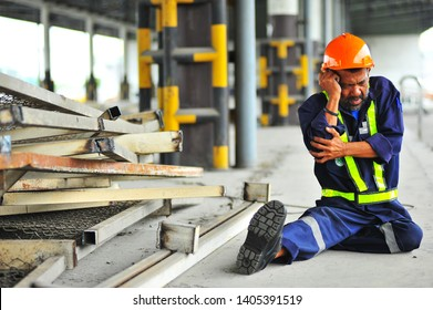Senior worker with broken arm working accident because work in warehouse.