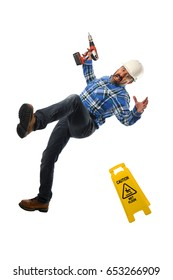 Senior worker wearing hard hat falling down isolated over white background