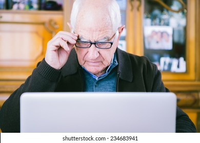 Senior working with Laptop at home
