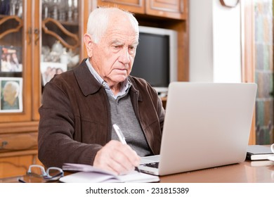 Senior working with Laptop, retired old man