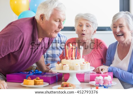 Seniors Celebrating A Birthday In Retirement Home