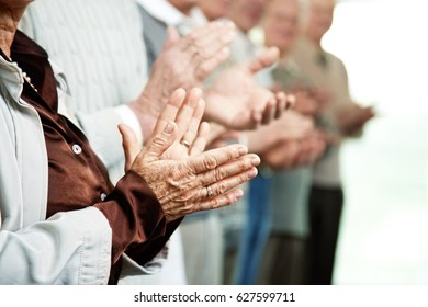seniors clapping with their hands