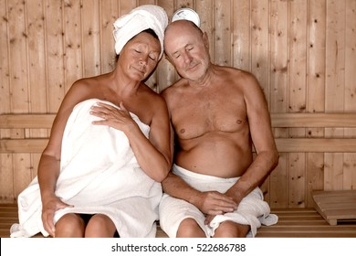seniors couple relaxing in sauna