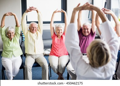 Seniors doing exercises in a retirement home