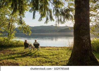 Seniors enjoying sunset at Cottage Grove Lake, OR, USA