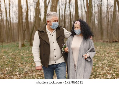 Seniors in a forest. Coronavirus theme.
