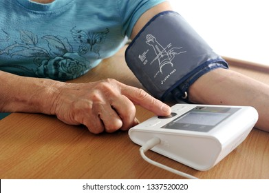 Senior's hand try to measure her blood pressure and digital heart rate.Health care and Medical concept.