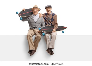 Seniors with longboards sitting on a panel isolated on white background