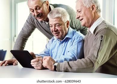 seniors looking at tablet computer