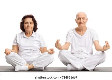 Seniors meditating on an exercise mat isolated on white background