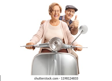 Seniors riding a retro scooter making a thumb up gesture isolated on white background