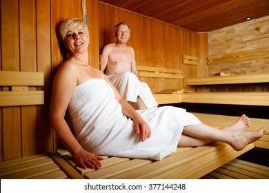 Seniors in sauna sweating and relaxing