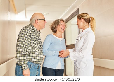 Seniors shaking hands Hands with geriatric nurse in retirement home