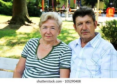 Seniors sitting on bench in park