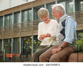 Seniors sitting on a wall