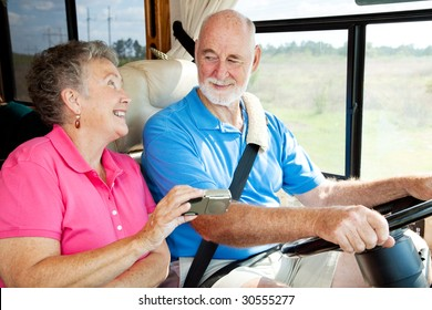 Seniors taking a trip in their motor home, using a GPS to navigate.