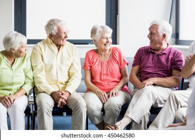 Seniors talking to each other in a retirement home