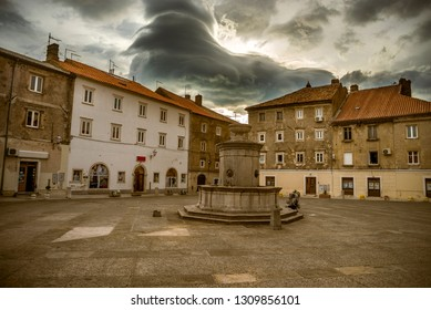 Senj, Croatia-02.August 2018., Gigantic cumulonimbus cloud above the city  during the summer afternoon. These clouds are enormously large, rare and very frightening. Here is framed against calm mood.