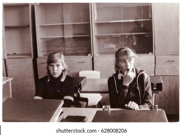SENNO, BELARUS - CIRCA 1985: Two schoolgirls-tenth graders in classroom on break (vintage photo 1985), Senno, Belarus