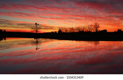 Sensational sunrise in rural Australia with reflections in farm dam