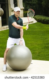 with a sense of humor you can see a a squash player playing with a fitness ball