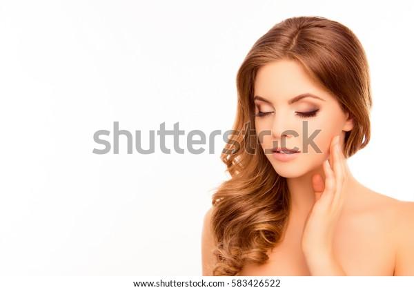 Sensitive young beautiful woman touching her face